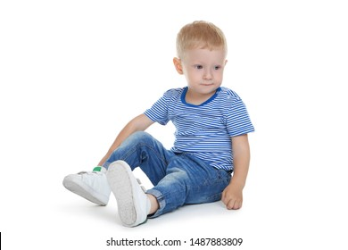 Little boy in fashion clothing sitting on white background