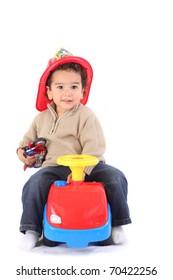 Little boy in fireman's helmet
