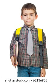 Little boy in first day on school holding bag and books isolated on white background