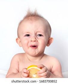 The little boy first tastes lemon
