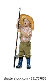 Little boy fisherman in a straw hat and rubber boots considering a fishing rod, isolated on white background.