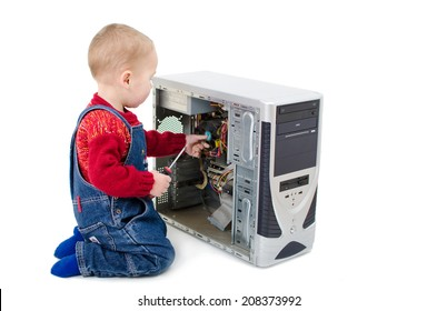 Little boy fixing a computer with a screwdriver
