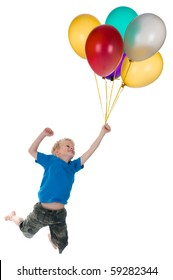 Little boy flying behind a bunch of balloons, isolated on a white background.