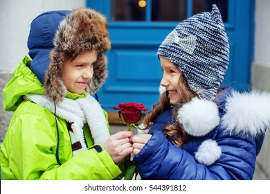The little boy gave the flower girl. The concept of love and Valentine's Day.