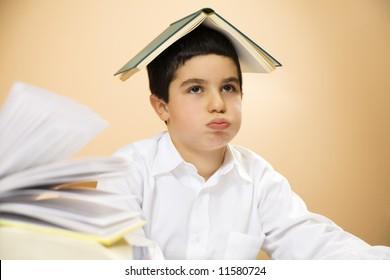 little boy getting bored of doing homeworks