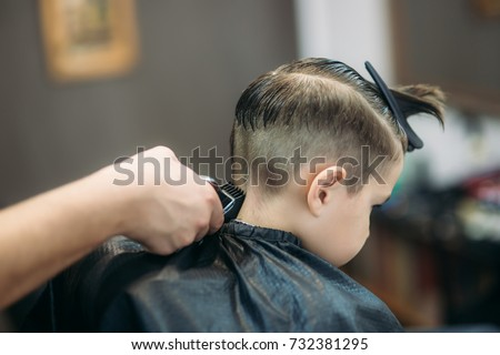 Little Boy Getting Haircut By Barber Stock Photo Edit Now
