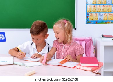 Little boy and girl in the classroom