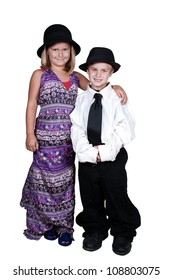 Little boy and girl dressed in oversized suit clothes