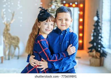 The little boy and girl hugging. Brother and sister. Concept Happy Christmas, New Year, holiday, winter, childhood.