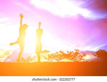 little boy with little girl jumping to sky and having happy time, Silhouette concept