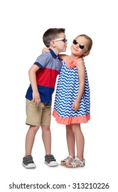 little boy and girl kissing isolated on white.