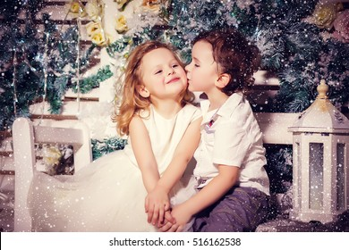 Little boy and girl in love in christmas