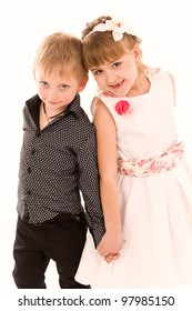 Little boy and girl in love isolated on white