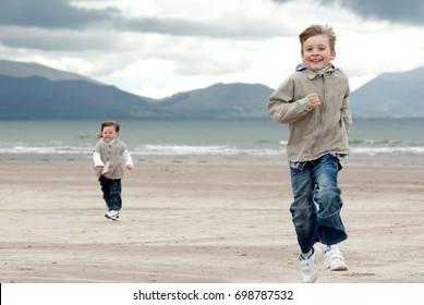 Little boy and a girl on irish seaside