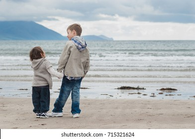 Little boy and a girl on irish seaside