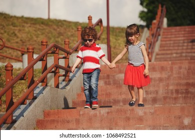 little boy and girl on stairway