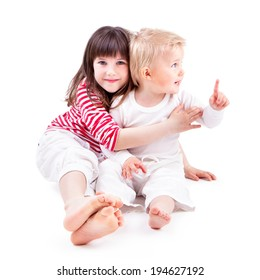LITTLE BOY AND GIRL ON WHITE BACKGROUND