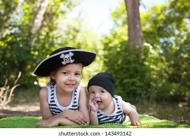 The little boy and girl in pirate costume