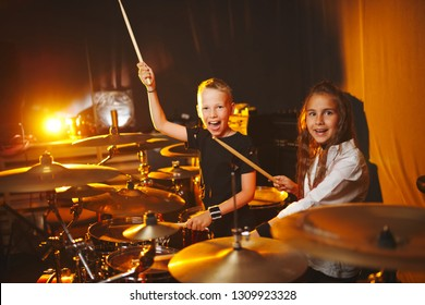 little boy and girl play drums in recording studio