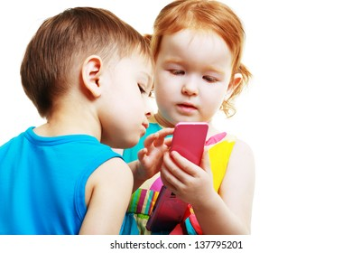 little boy and girl playing with mobile phone