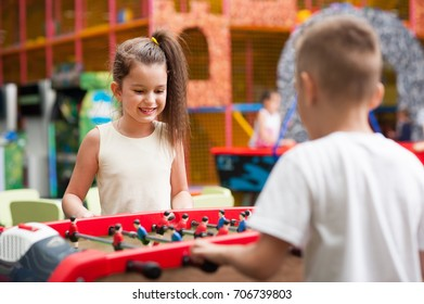little boy and girl playing table football