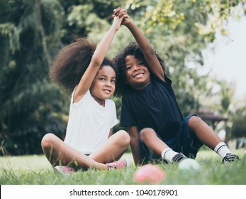Little boy and girl playing together in a park