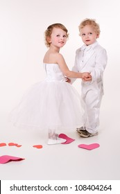 little boy and girl playing wedding