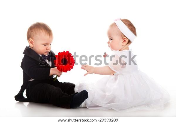 little boy and girl playing wedding