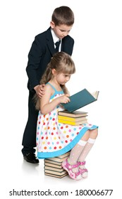 Little boy and girl are reading against the white background
