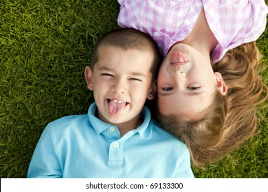 Little boy and girl sitting outside