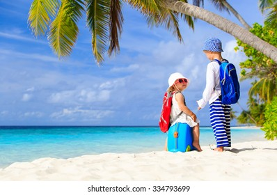 little boy and girl travel on summer tropical beach, family vacation