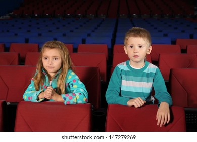 Little boy and girl watching a movie