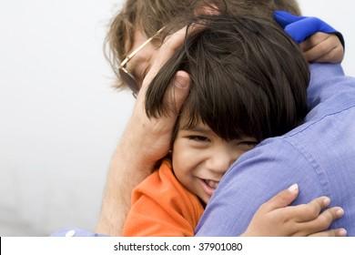 Little boy giving his father a big hug