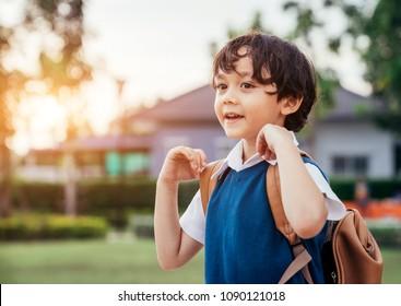 A little boy go to school in semester start day.