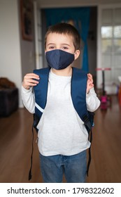 Little boy going back to school. New normal after pandemic, wearing face mask