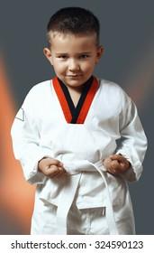 little boy with green eyes in white kimono