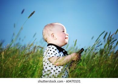 little boy in green grass
