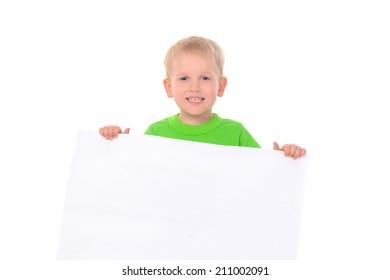 little boy in green t-shirt behind white board