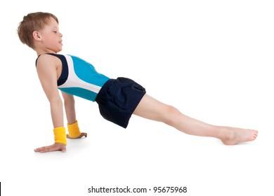 little boy gymnast doing exercises