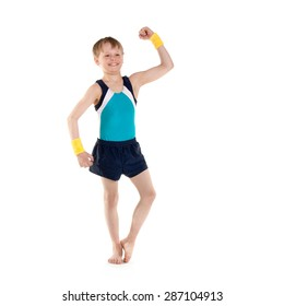 little boy gymnast showing his muscles