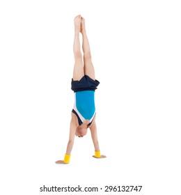 little boy gymnast standing head over feet