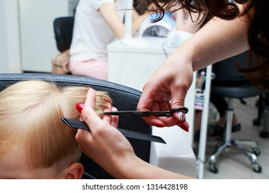 the little boy in a hairdressing salon