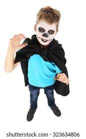 Little boy in halloween costume on white background