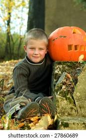 Little boy with halloween pumpkin