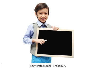 little boy with hand holding empty chalkboard on white background