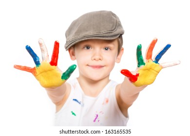 little boy with hands in paint isolated on white