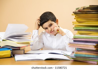 little boy has troubles with homeworks and is scratching his head