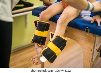 little boy have a  physiotherapy session. Legs and feet with additional load