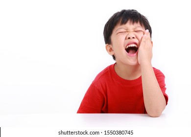 Little boy having toothache. Emotional portrait of asian boy suffering. Sad child with tooth pain. Dental problem