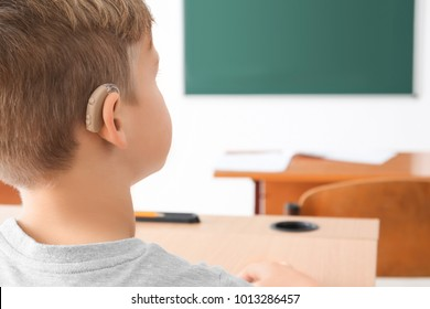 Little boy with hearing aid, closeup
